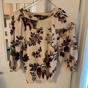 Flowery soft sweater.